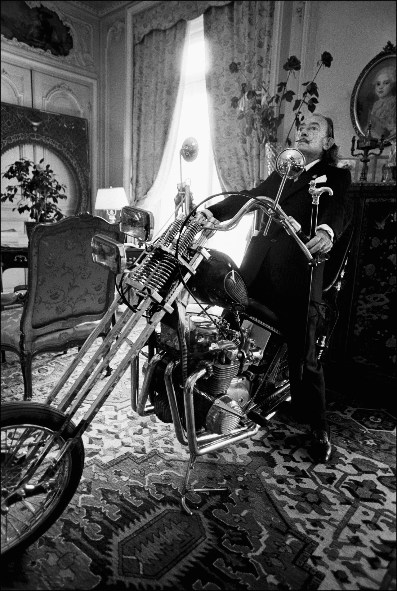 Spanish artist Salvador Dali poses on a Harley Davidson motorbike at the Le Meurice Hotel on October 24,1973 in Paris,France. (Photo by Ulf Andersen/Getty Images)